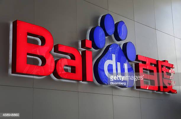 The Baidu Inc logo is displayed in the reception are of the company's headquarters in Beijing China on Wednesday Nov 12 2014 While Beijingbased Baidu...
