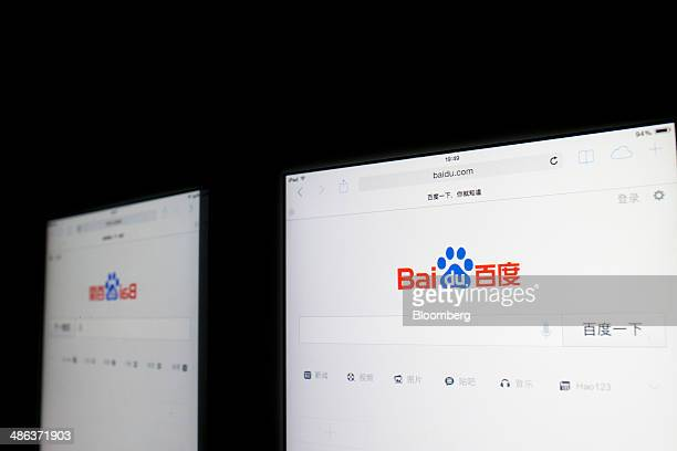 The Baidu Inc website reflected in a mirror is displayed on an Apple Inc iPad in an arranged photograph in Hong Kong China on Tuesday April 22 2014...