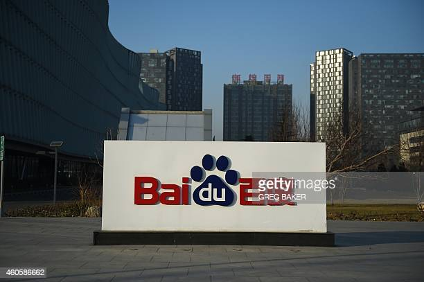 The Baidu logo is seen outside the Baidu headquarters in Beijing on December 17, 2014. Baidu, China's leading search engine, and ride sharing company...