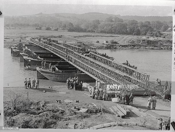 The Bailey Bridge a new USBritish war creation which is proving of immentse balue to the allied operations and answe4r to enemy demolition Its use...