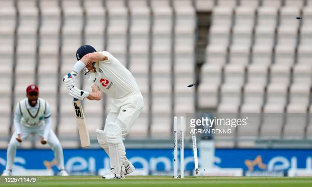 The bails and stumps go flying as England's Joe Denly is bowled out by West Indies' Shannon Gabriel on the second day of the first Test cricket match...