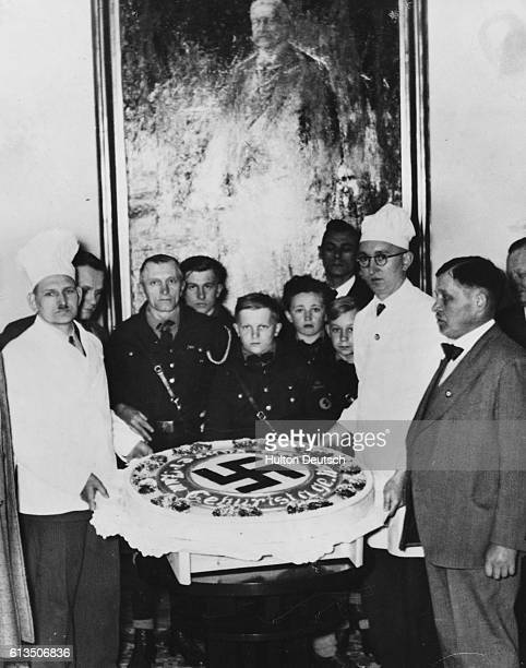 The Baker's Union in Berlin displays a giant birthday cake decorated with a swastika motif that they have made for Adolf Hitler's 47th birthday.