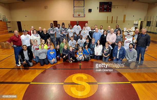 The Bakersfield Jam players and staff along with school employees and volunteers pose for a group photo during the Bakersfield Jam Thanksgiving Box...