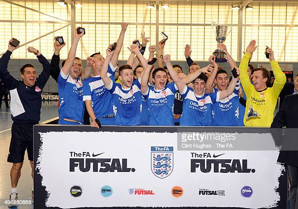The Baku United team celebrate their victory in the grand final during the Futsal Grand Finals at St Georges Park on May 31, 2014 in Burton Upon...