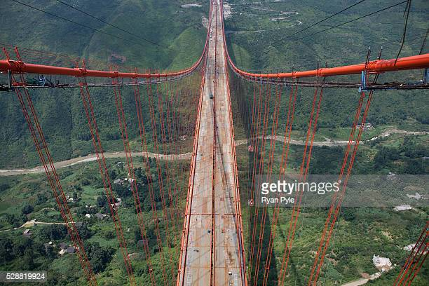 The Baling River Bridge due to be completed in early 2010 is one of China's longest suspension bridges Measuring 14 miles the project is a marvel of...