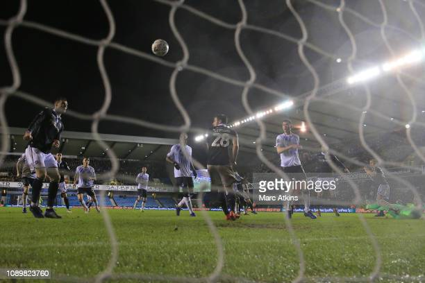 The ball appears to deflect from the arm of Jake Cooper of Millwall for their 2nd goal during the FA Cup Fourth Round match between Millwall and...