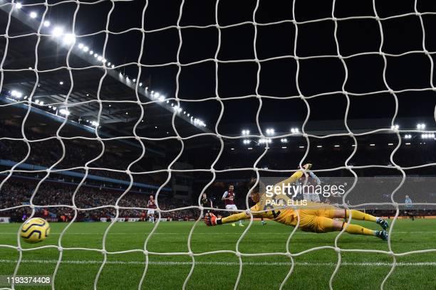 The ball beats Aston Villa's Norwegian goalkeeper Orjan Nyland for Manchester City's Argentinian striker Sergio Aguero's second and City's fifth goal...