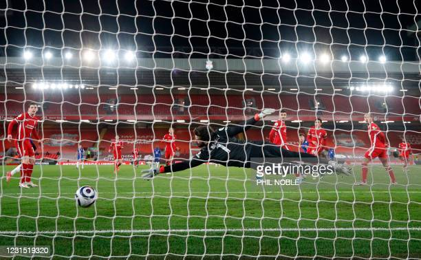 The ball beats Liverpool's Brazilian goalkeeper Alisson Becker from a shot from Chelsea's English midfielder Mason Mount for the opening goal during...
