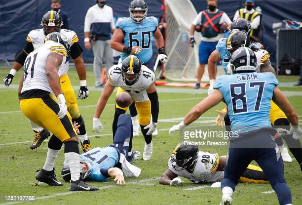 The ball bounces after quarterback Ryan Tannehill of the Tennessee Titans is knocked to the ground by Robert Spillane of the Pittsburgh Steelers...