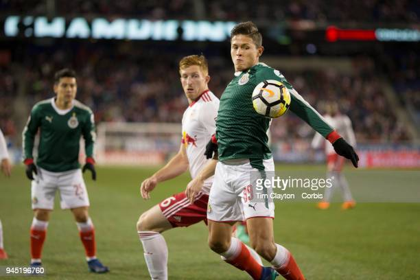 The ball bounces up onto the arm of Jose Godinez of CD Guadalajara but penalty appeals were turned down during the New York Red Bulls Vs CD...