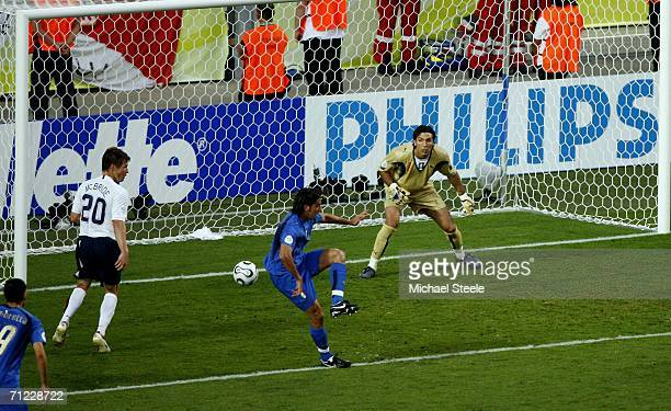 The ball deflects off Cristian Zaccardo of Italy and into the net for an own goal during the FIFA World Cup Germany 2006 Group E match between Italy...