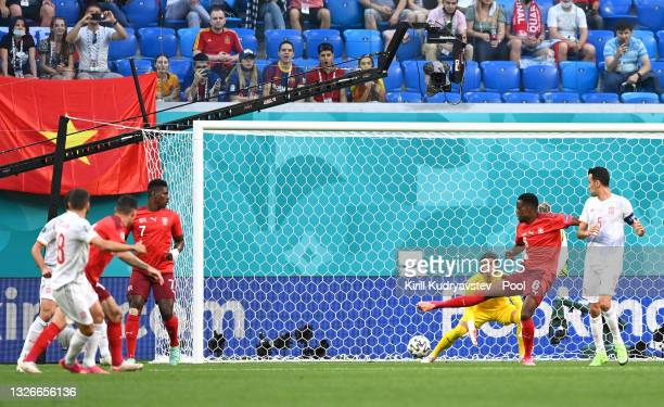 The ball deflects off Denis Zakaria of Switzerland past Yann Sommer leading to the Spain first goal scored by Jordi Alba during the UEFA Euro 2020...