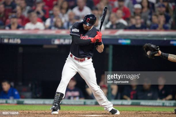 The ball deflects off the bat of Cleveland Indians outfielder Lonnie Chisenhall and into the glove of New York Yankees catcher Gary Sanchez , however...