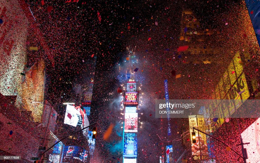 The ball drops to enter in the new year during New Year's Eve celebrations in Times Square on January 1, 2018 in New York. /