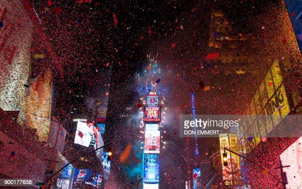 The ball drops to enter in the new year during New Year's Eve celebrations in Times Square on January 1 2018 in New York / AFP PHOTO / DON EMMERT