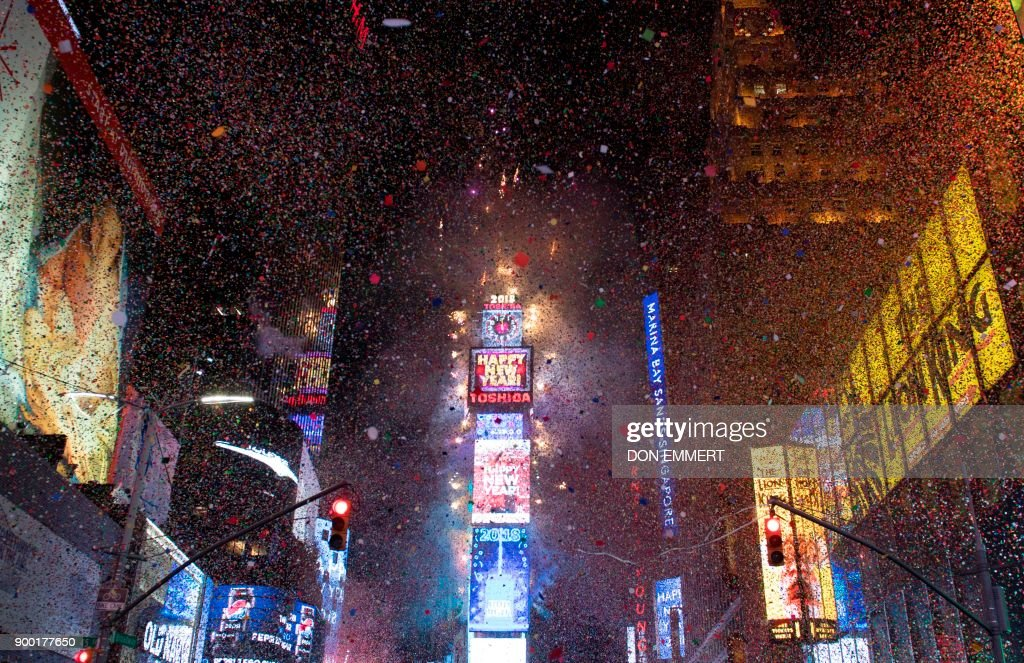 TOPSHOT - The ball drops to enter in the new year during New Year's Eve celebrations in Times Square on January 1, 2018 in New York. /