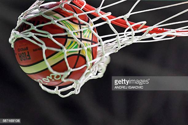 The ball enters the basket during a Men's round Group A basketball match between USA and Venezuela at the Carioca Arena 1 in Rio de Janeiro on August...