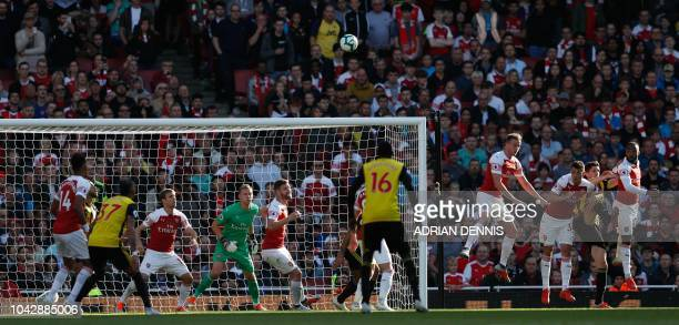 The ball flies across from a Watford corner during the English Premier League football match between Arsenal and Watford at the Emirates Stadium in...