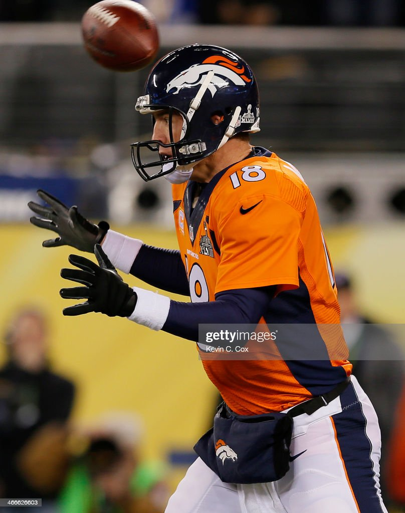 The ball flies over the head of quarterback Peyton Manning #18 of the Denver Broncos in the first quarter against the Seattle Seahawks during Super Bowl XLVIII at MetLife Stadium on February 2, 2014 in East Rutherford, New Jersey.