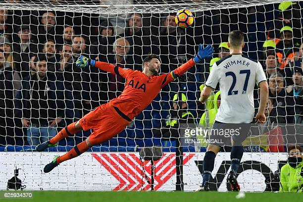 The ball flies past Tottenham Hotspur's French goalkeeper Hugo Lloris to slam into the back of the net from a shot from Chelsea's Spanish midfielder...