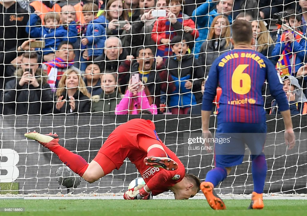 The ball gets away from Barcelona's German goalkeeper Marc-Andre Ter Stegen to concede a goal during the Spanish league footbal match between FC Barcelona and Valencia CF at the Camp Nou stadium in Barcelona on April 14, 2018. /