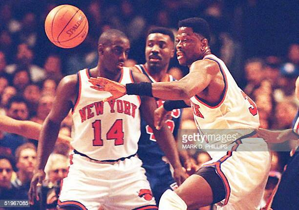 The ball gets away from New York Knicks Patrick Ewing as teammate Anthony Mason blocks out New Jersey Nets Armon Gilliam during the first half of...