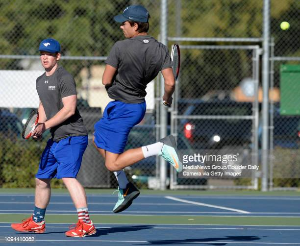 The ball gets between Dawson's Max McClellan left and Jackson Kegel in the doubles championship final during the Longmont Invite tennis tournament...
