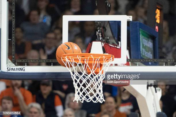 The ball gets stuck between the rim and the backboard during the first half of the Miami Hurricanes versus Virginia Cavaliers game on February 2 at...