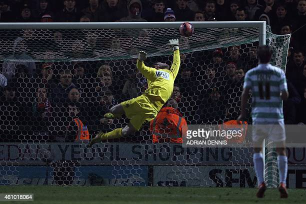 The ball goes beyond Yeovil Town's English goalkeeper Jed Steer as he dives but fails to save the shot from Manchester United's Spanish midfielder...
