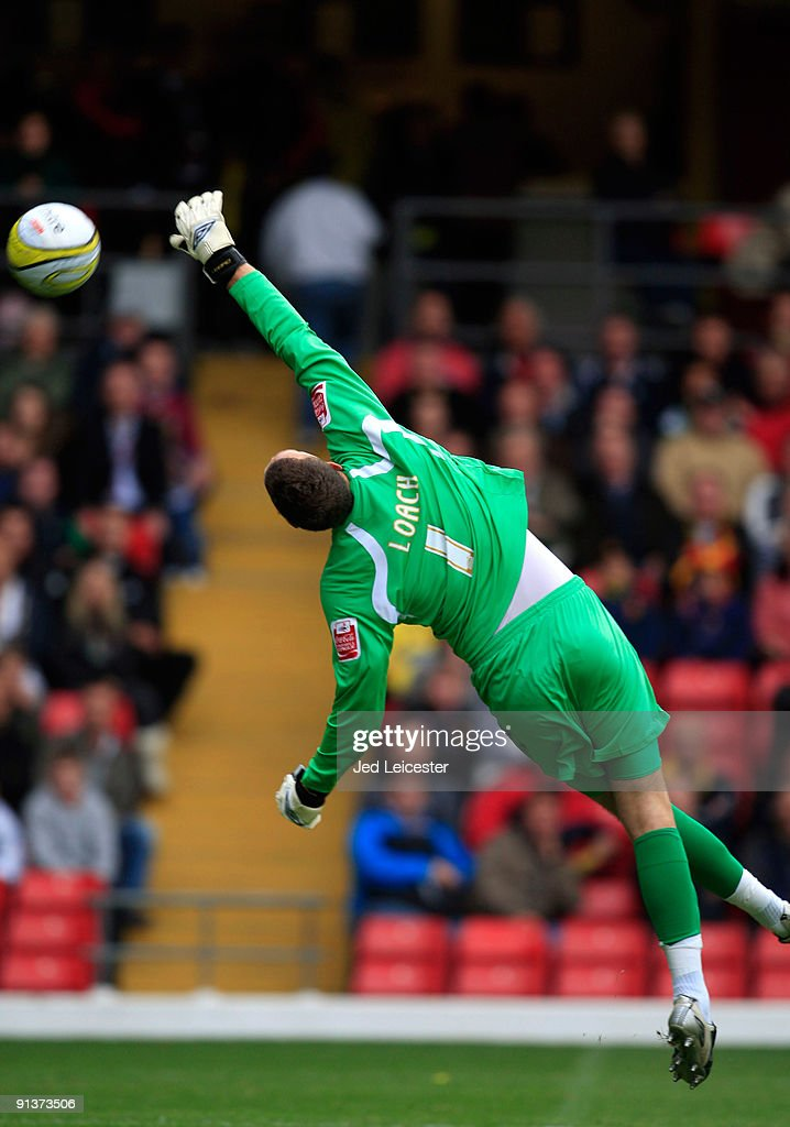 The ball goes over the head of Watford goalkeeper Scott Loach and into the goal after a long range speculative freekick from Cardiff City's Adam Matthews during the Watford and Cardiff City Coca Cola Championship match at Vicarage Road on October 3, 2009 in Watford, England.