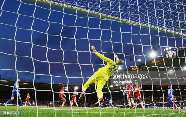 The ball goes past Darren Randolph of Middlesborough after it has ricochet off Glenn Murray of Brighton and Hove Albion during the The Emirates FA...