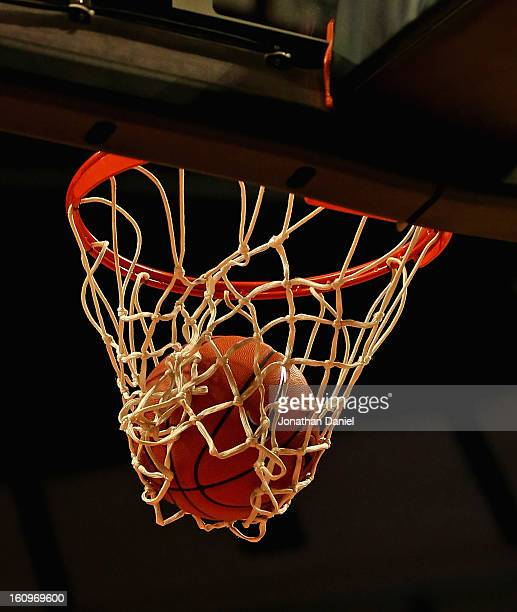The ball goes through the basket during a game between the Illinois Fighting Illini and the Auburn Tigers at United Center on December 29 2012 in...