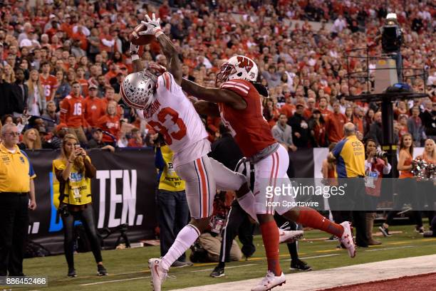 The ball goes through the hands of Ohio State Buckeyes wide receiver Terry McLaurin during the Big Ten Championship Game between the Ohio State...