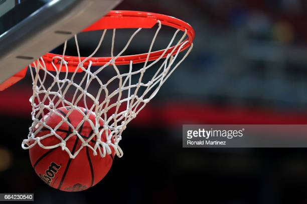 The ball goes through the hoop during warm ups before the game between the North Carolina Tar Heels and the Gonzaga Bulldogs during the 2017 NCAA...