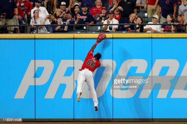The ball hit by Chicago White Sox left fielder Eloy Jimenez gets over the glove of Cleveland Indians right fielder Yasiel Puig for a home run during...