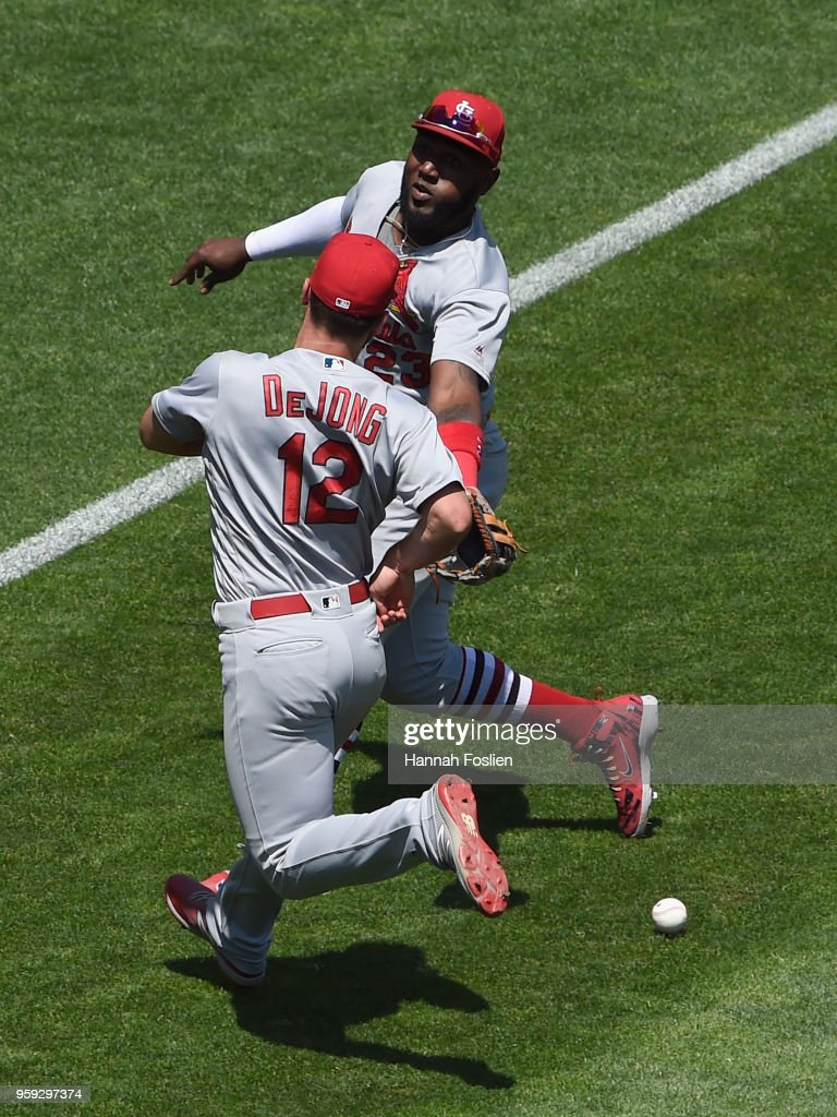 The ball hit by Eddie Rosario #20 of the Minnesota Twins drops between Paul DeJong #12 and Marcell Ozuna #23 of the St. Louis Cardinals during the fifth inning of the interleague game on May 16, 2018 at Target Field in Minneapolis, Minnesota. The Cardinals defeated the Twins 7-5.