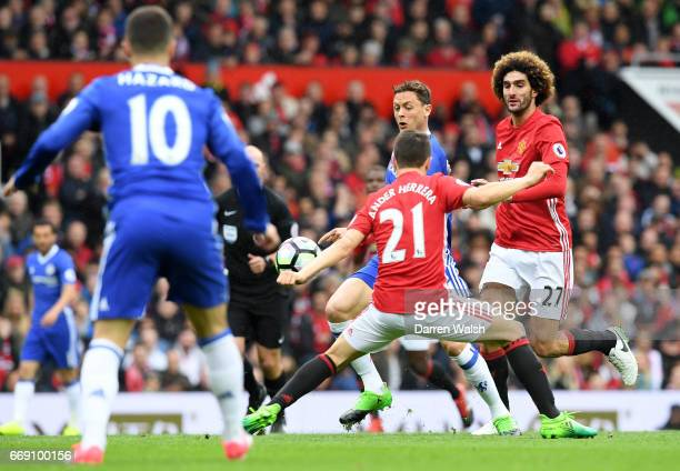 The ball hits the arm of Ander Herrera of Manchester United during the Premier League match between Manchester United and Chelsea at Old Trafford on...