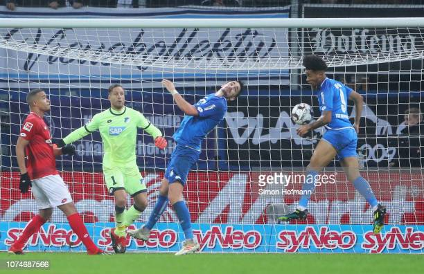 The ball hits the arm of Reiss Nelson of 1899 Hoffenheim as he attempts to clear during the Bundesliga match between TSG 1899 Hoffenheim and 1. FSV...