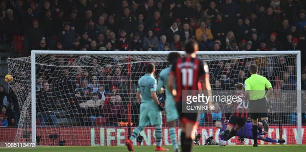 The ball hits the back of the net after a strike from Bournemouth's Norwegian striker Joshua King beat Arsenal's German goalkeeper Bernd Leno for...