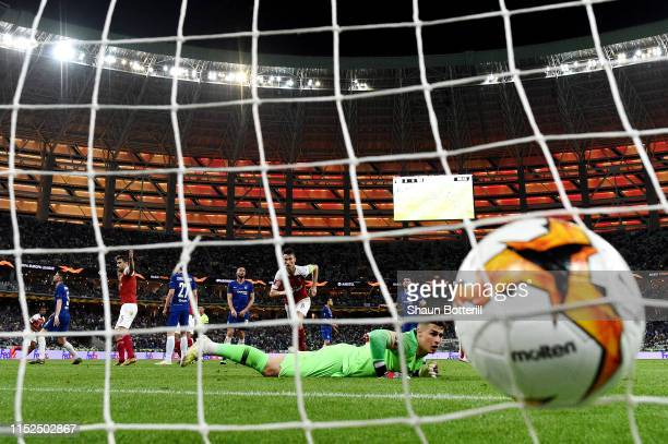 The ball hits the back of the net as Alex Iwobi of Arsenal scores his team's first goal past Kepa Arrizabalaga of Chelsea during the UEFA Europa...