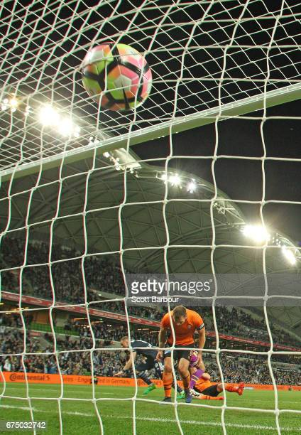 The ball hits the back of the net as Besart Berisha of the Victory celebrates as he scores the winning goal during the ALeague Semi Final match...