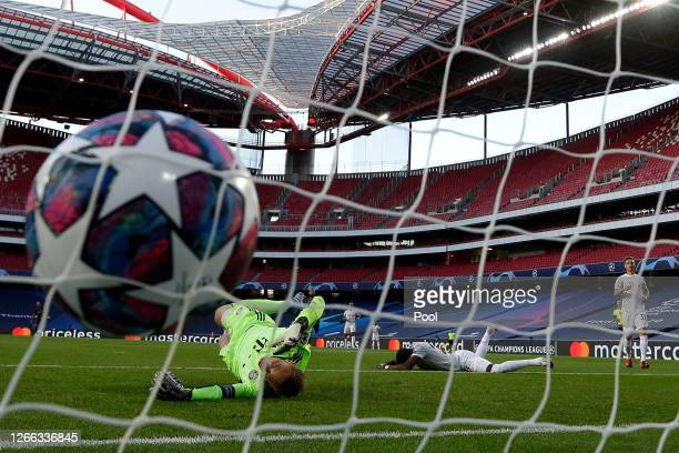 The ball hits the back of the net as David Alaba of FC Bayern Munich scores an own goal past Manuel Neuer of FC Bayern Munich for FC Barcelona's...