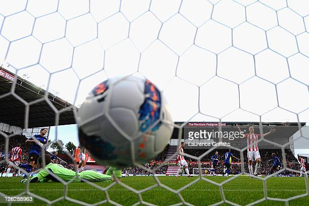 The ball hits the back of the net as Nani of Manchester United scores the opening goal during the Barclays Premier League match between Stoke City...