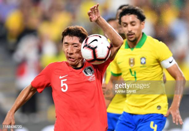 The ball hits the face of South Korea's Jung Woo-young during the friendly football match between Brazil and South Korea at Mohammed Bin Zayed...