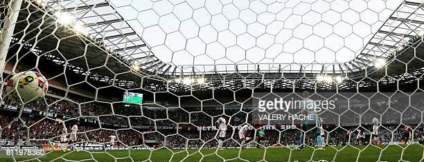 The ball hits the net after Nice's Italian forward Mario Balotelli scored a goal during the French L1 football match Nice vs Lorient on October 2...