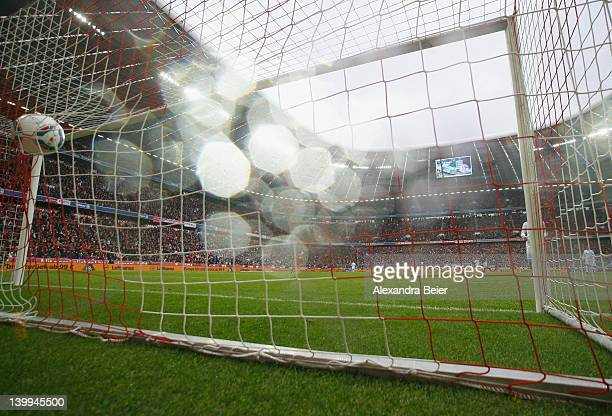 The ball is scored into the empty goal of Schalke by Franck Ribery during the Bundesliga match between FC Bayern Muenchen and FC Schalke 04 at...