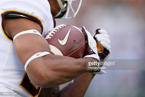 The ball is seen as Demetrius Douglas of the Minnesota Golden Gophers carries it against the New Mexico State Aggies during the game on August 30...