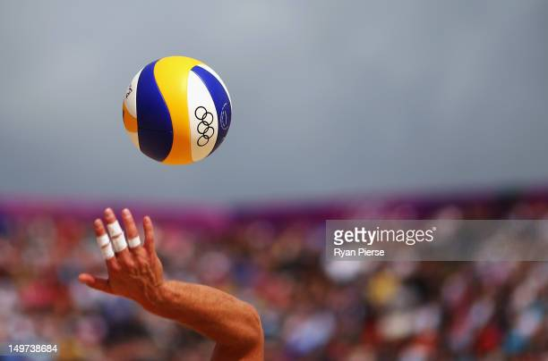 The ball is served during the Men's Beach Volleyball Round of 16 match between Switzerland and Poland on Day 7 of the London 2012 Olympic Games at...