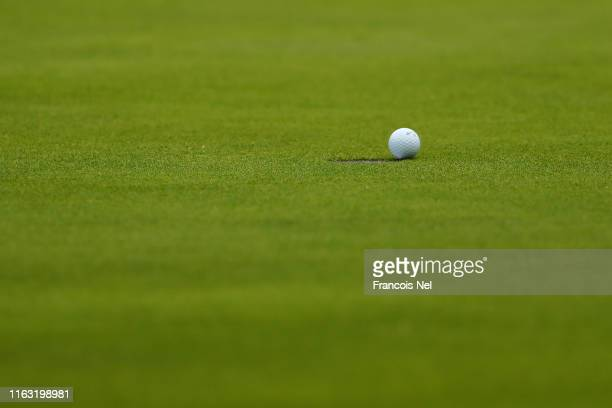 The ball of Jon Rahm of Spain sits on the edge of the hole on the 18th green during the third round of the 148th Open Championship held on the...