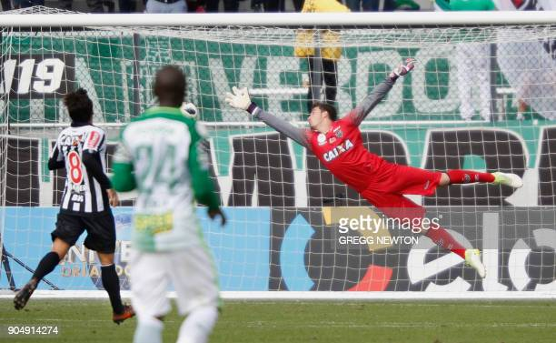 The ball partially obscured sails on target past goal keeper Cleiton of Brazilian club Atletico Mineiro for a second half goal by Jeison Lucumi of...
